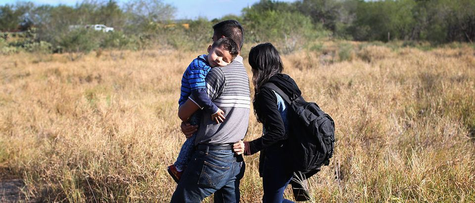 A father carries his sleeping son, 3, after their family illegally crossed the U.S.-Mexico border on December 7, 2015 near Rio Grande City, Texas. The father said he was bringing his family from Guanajuato, Mexico to settle in San Antonio, Texas. They were detained by the U.S. Border Patrol. The number of migrant families and unaccompanied minors crossing the border has surged in recent months, even as the total number of illegal crossings nationwide has gone down from the previous year. (Photo by John Moore/Getty Images)