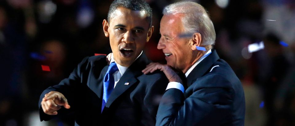 U.S. President Barack Obama gestures with Vice President Joe Biden after his election night victory speech in Chicago, November 6, 2012. REUTERS/Larry Downing (UNITED STATES - Tags: POLITICS TPX IMAGES OF THE DAY USA PRESIDENTIAL ELECTION ELECTIONS) - TB3E8B70K72TL