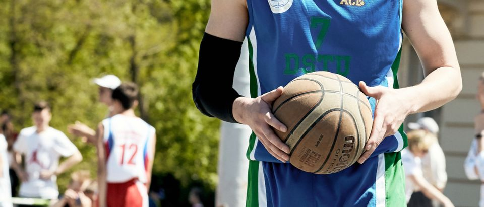 Russia, Rostov-on-Don - May 1, 2018: A group of young guys playing street basketball in the city square. The concept of a healthy lifestyle in youth culture. Shutterstock/ SergeyKlopotov | Man Busted For Posing As HS Student