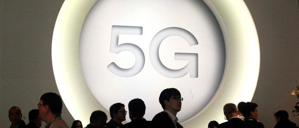 A 5G sign is pictured at the Quantum stand during the Mobile World Congress (MWC), the world's biggest mobile fair, on February 27, 2018 in Barcelona. The Mobile World Congress is held in Barcelona from February 26 to March 1.(Photo by Miquel Benitez/Getty Images)