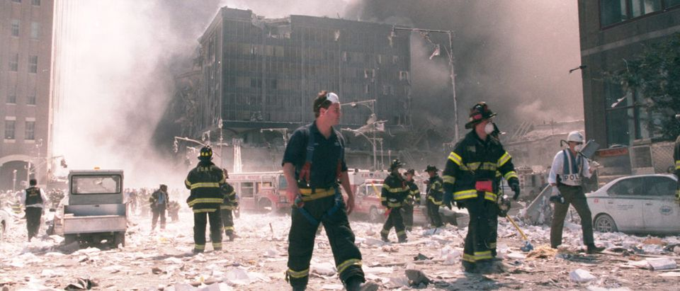 New York City firefighters work near the area known as Ground Zero after the collapse of the Twin Towers September 11, 2001 in New York City. (Shutterstock / Anthony Correia)