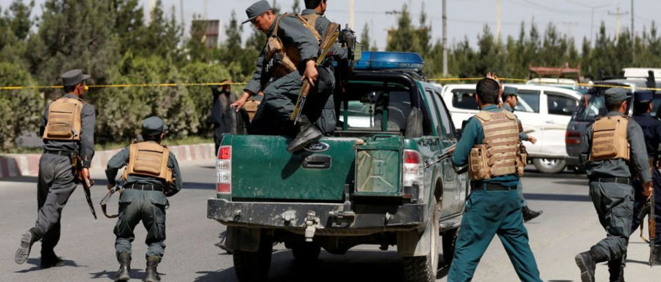 Afghan policemen arrive at the site of an attack in Kabul, Afghanistan