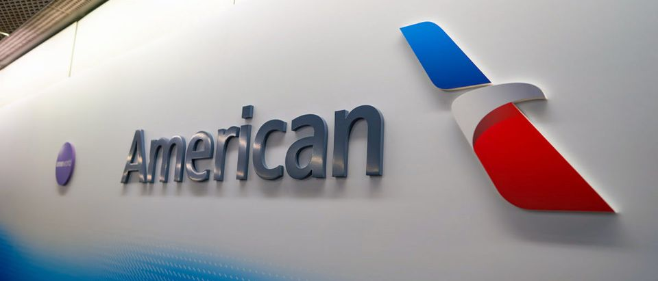 American Airlines logo on the wall at Chicago O'Hare International Airport. American Airlines, Inc. is a major American airline headquartered in Fort Worth, Texas- ShutterStock Sorbis