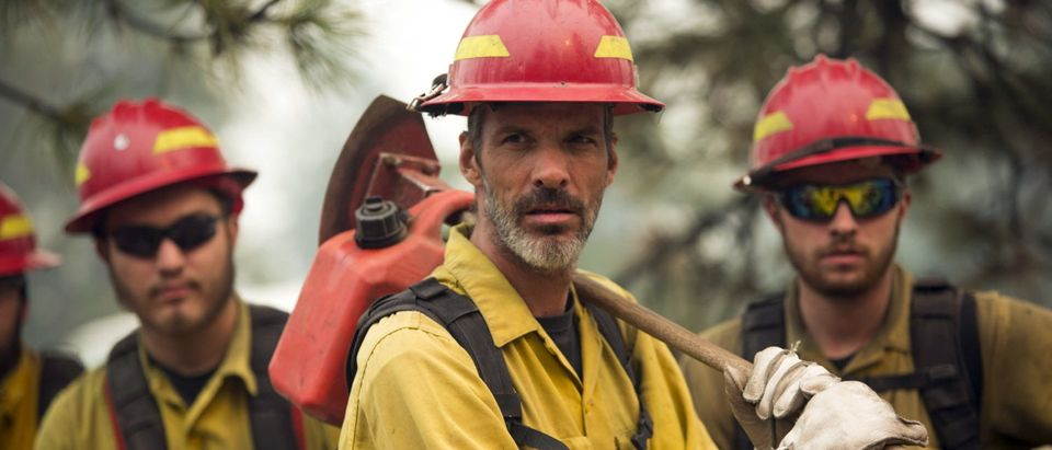 Members of a handcrew prepare to head out during the Okanogan Complex Fire near Tonasket, Washington, Aug. 22, 2015. REUTERS/Jason Redmond