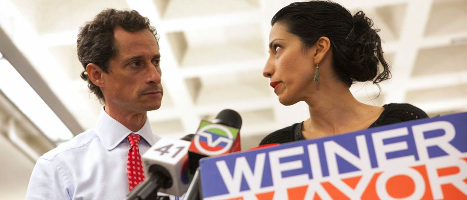 New York mayoral candidate Anthony Weiner and his wife Huma Abedin attend a news conference in New York, on July 23, 2013. REUTERS/Eric Thayer/File Photo