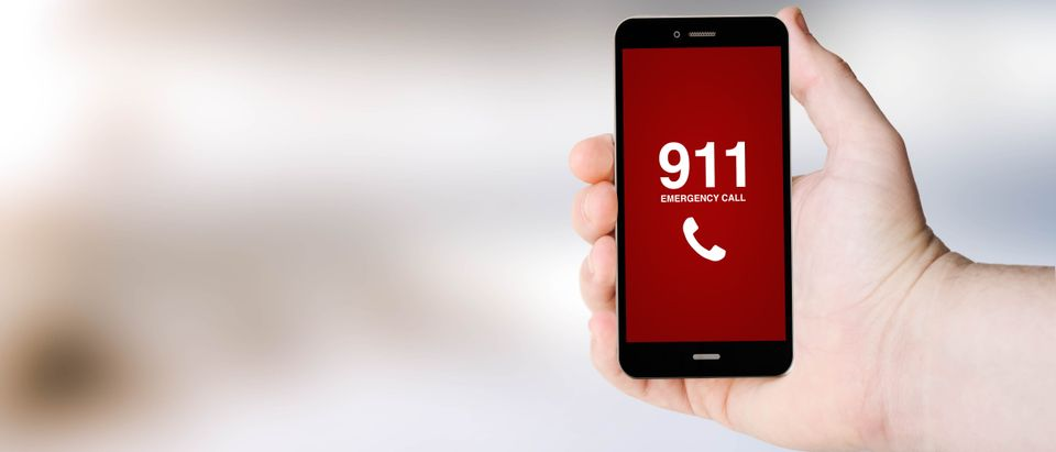 Safety concept: 911 sign on digital generated phone screen with sea background. All screen graphics are made up. Georgejmclittle Royalty-free stock photo ID: 321765251
