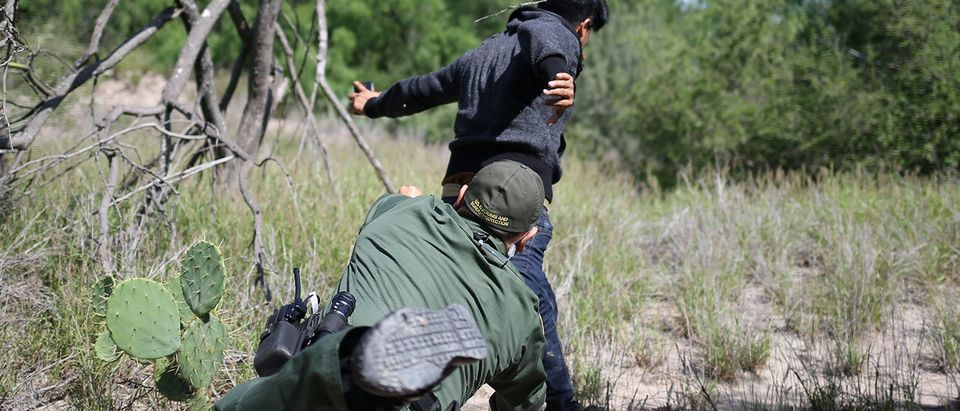A man who illegally crossed the Mexico-U.S. border evades a U.S. Border Patrol agent near McAllen