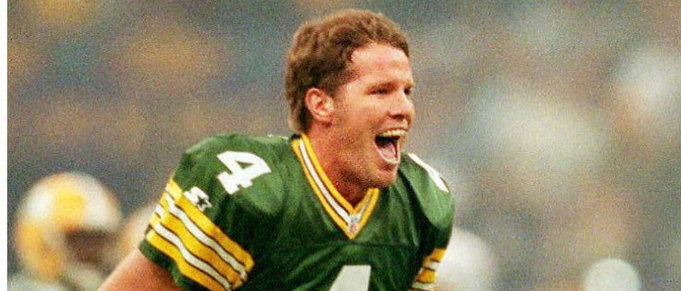 NEW ORLEANS, UNITED STATES: Green Bay Packers quarterback Brett Favre celebrates his first quarter touchdown pass to Andre Rison 26 January against the New England Patriots in Super Bowl XXXI in New Orleans, Louisiana. AFP PHOTO/Don EMMERT (Photo credit: DON EMMERT/AFP/Getty Images)