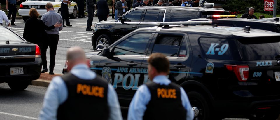 Law enforcement officials survey shooting scene at Capital Gazette newspaper in Annapolis, Maryland