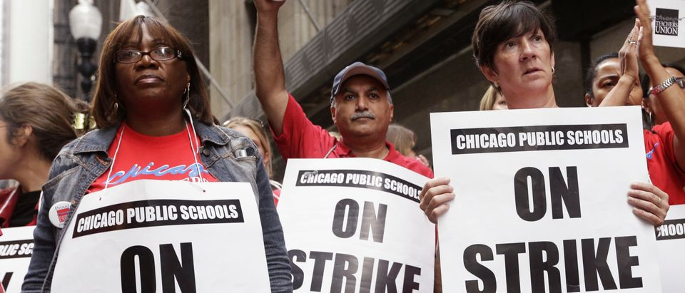 Chicago Teachers Union members picket outside of the CPS headquarters in Chicago