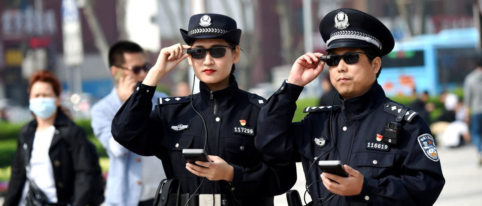 Police officers display their AI-powered smart glasses in Luoyang