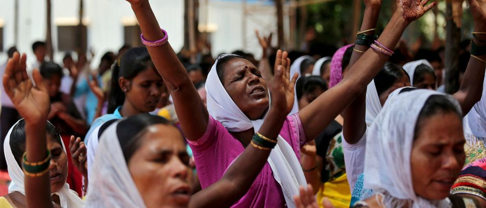 Women chant hymns during a sit-in rally in support of various demands including reservation in government jobs for Christians, in Mumbai