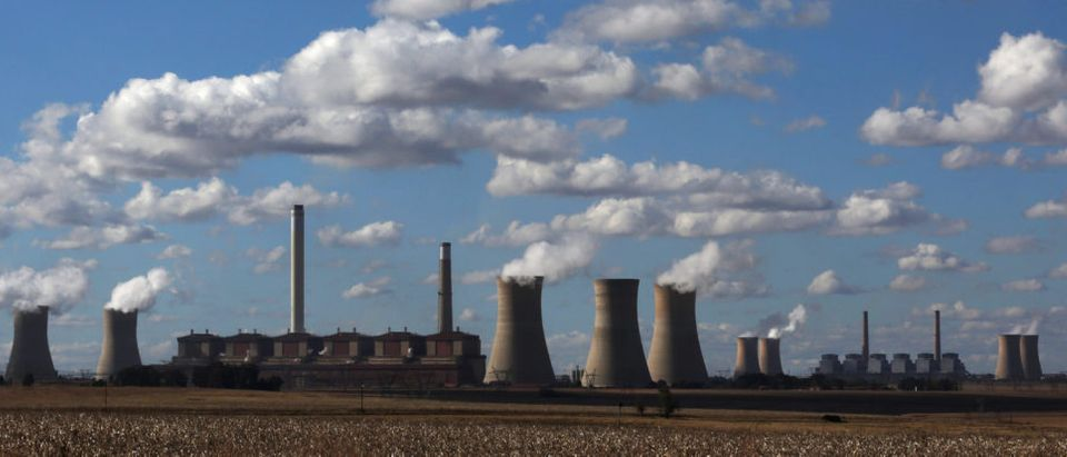 Steam rises from the cooling towers of Matla Power Station, a coal-fired power plant operated by Eskom in Mpumalanga province