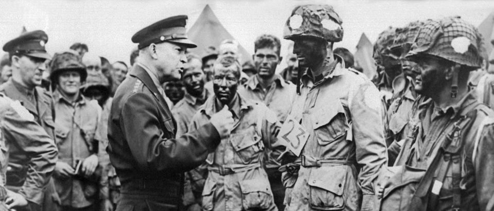 Picture of supreme commander for the 1944 cross-channel invasion of the continental mainland, general Dwight D. Eisenhower giving order of the day to the paratroopers, just before they board their airplane to participate in the first assault in the invasion of the continent of Europe, 06 June 1944, England. (Photo credit should read AFP/AFP/Getty Images)