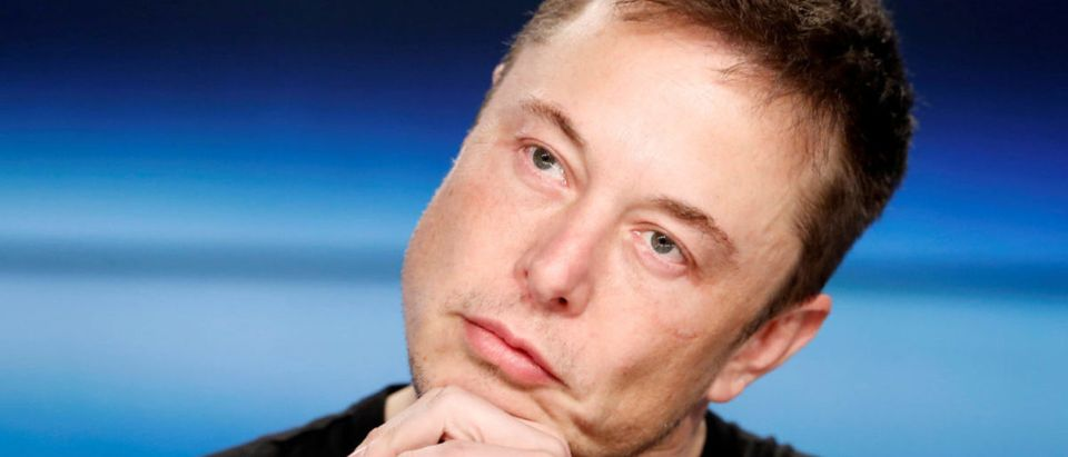 Elon Musk listens at a press conference following the first launch of a SpaceX Falcon Heavy rocket at the Kennedy Space Center in Cape Canaveral, Florida, U.S., Feb. 6, 2018. REUTERS/Joe Skipper