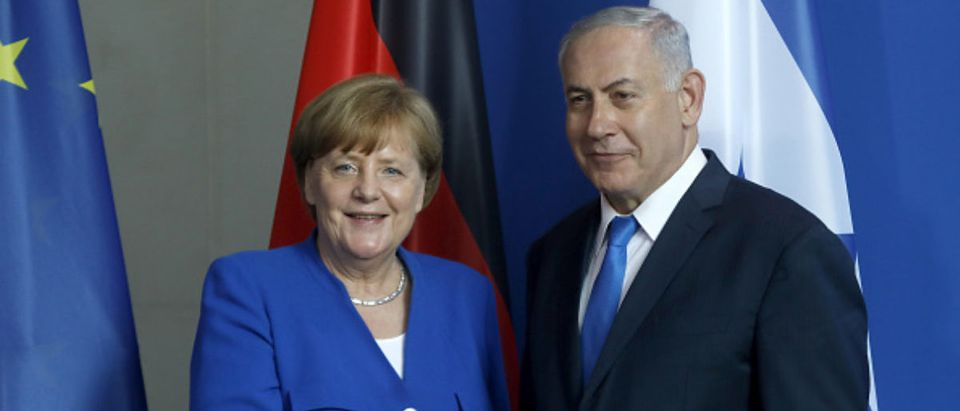 BERLIN, GERMANY - JUNE 04: German Chancellor Angela Merkel (CDU) and Israel's Prime minister Benjamin Netanyahu shake hands after a joint press conference in the German Chancellory on June 4, 2018 in Berlin, Germany. The meeting focuses on bilateral relationship as well as the actual situation of Iran and war in Syria. (Photo by Michele Tantussi/Getty Images)