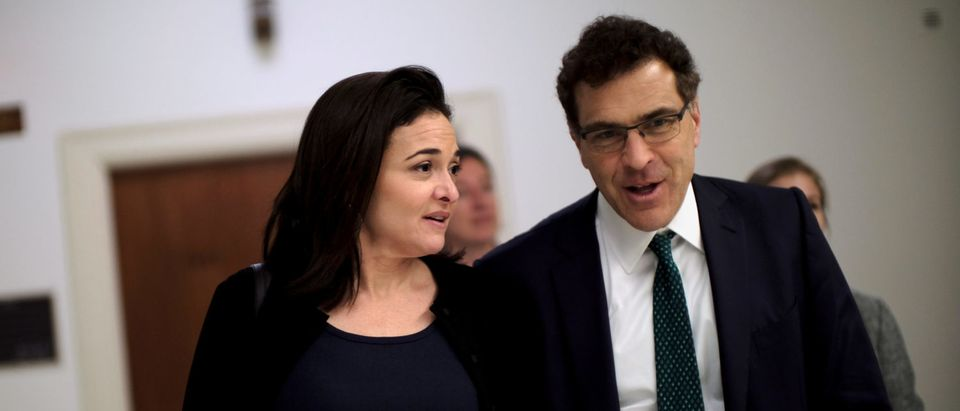FILE PHOTO: Facebook Chief Operating Officer Sheryl Sandberg and Vice President of global communications and public policy Elliot Schrage on Capitol Hill in Washington