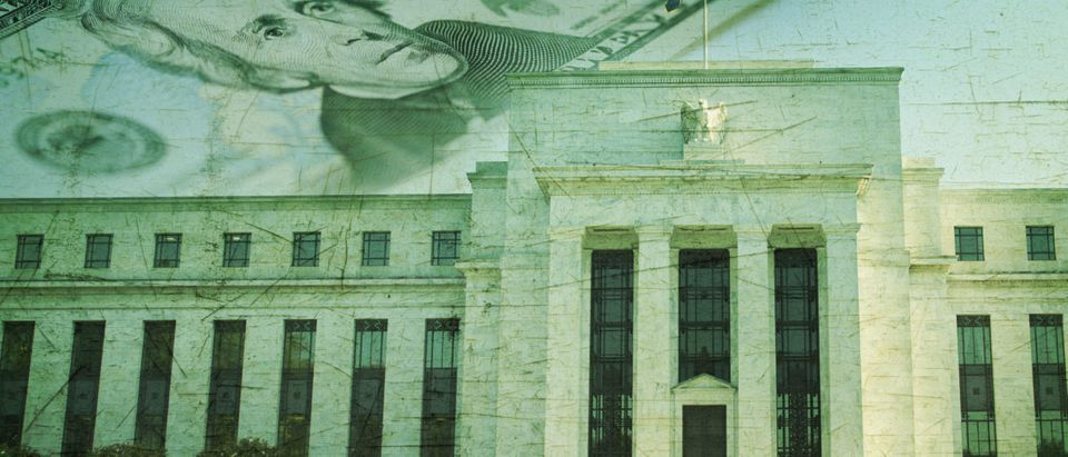 The Federal Reserve building in Washington DC superimposed on a twenty dollar bill and a grunge texture background - Shutterstock/Dan Thornberg