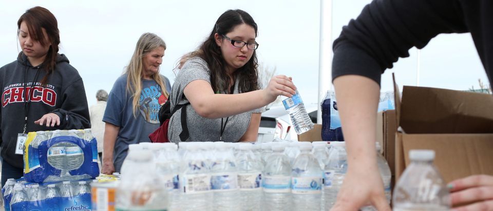 Kelly Flint of the Remi Vista Foster Care Agency organizes donated water at a Red Cross relief center in Chico, California, after an evacuation was ordered for communities downstream from the Lake Oroville Dam, in Oroville, California, February 13, 2017. REUTERS/Beck Diefenbach