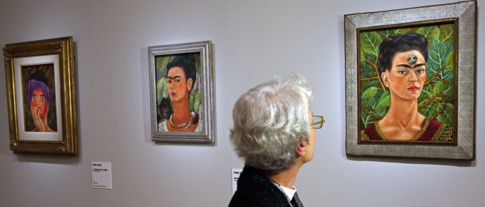 """The paintings """"Autoportrait au Singe"""" and """"En Pensant a la Mort"""" by Mexican artist Frida Kahlo during the presentation of the exhibition 'Frida Kahlo/Diego Rivera, Art in Fusion' at the Musee de l'Orangerie in Paris"""