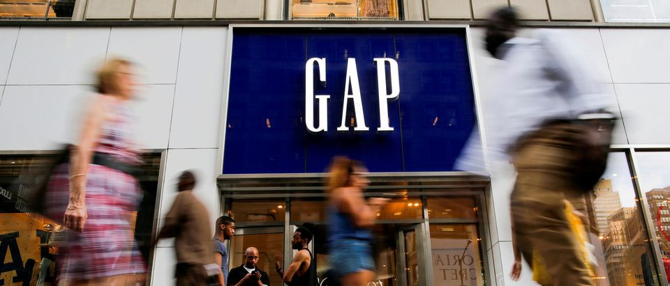 FILE PHOTO: File photo of people passing by the GAP clothing retail store in Manhattan, New York