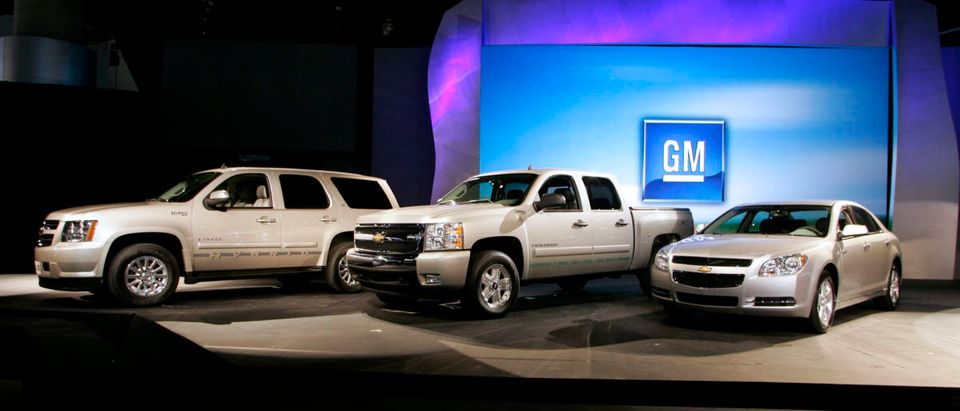General Motors' Chevrolet hybrid vehicles including the Chevrolet Tahoe Hybrid (L), the Chevy Silverado Hybrid (C), and the Chevy Malibu Hybrid are seen during the Los Angeles Auto Show in Los Angeles, California November 14, 2007. (REUTERS/Danny Moloshok)