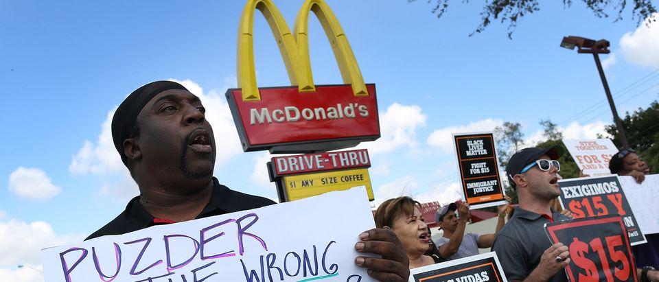 Protestors Rally At Miami Area McDonald's Against Puzder Nomination