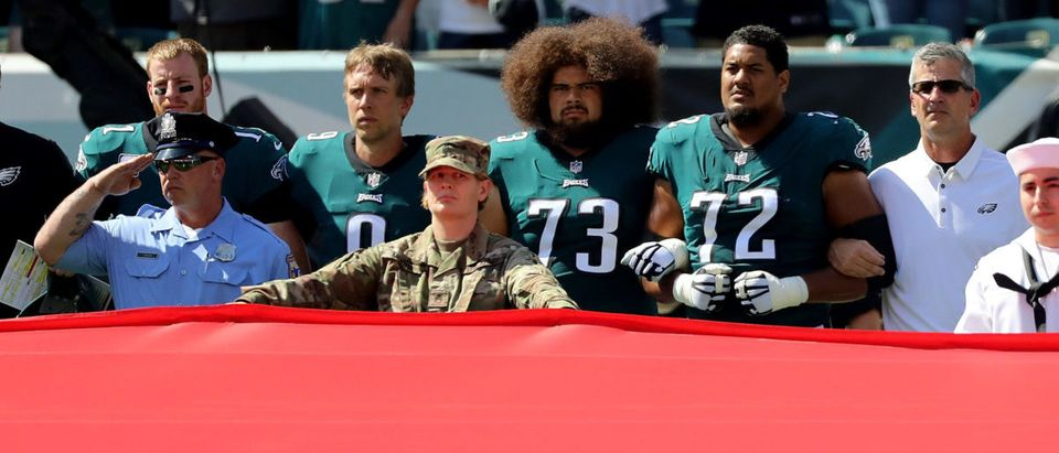 Philadelphia Eagles link arms during the national anthem before the game against the New York Giants on September 24, 2017. (Abbie Parr/Getty Images)