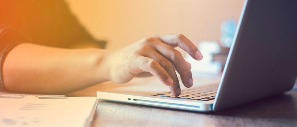Someone is typing on this computer. (Shutterstock/Sansoen Saengsakaorat)