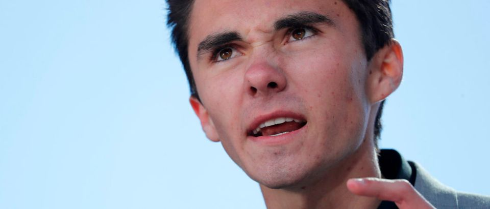 "David Hogg, a student at the Marjory Stoneman Douglas High School, site of a February mass shooting which left 17 people dead in Parkland, Florida, speaks as students and gun control advocates hold the ""March for Our Lives"" event demanding gun control after recent school shootings at a rally in Washington, U.S., March 24, 2018. REUTERS/Jonathan Ernst - HP1EE3O1DB9GE"
