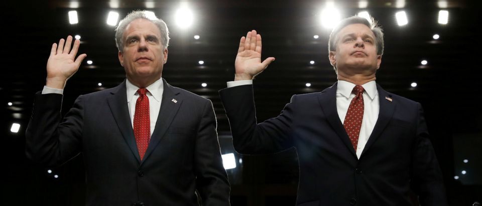 "Department of Justice Inspector General Horowitz and FBI Director Christopher Wray are sworn in to testify before a Senate Judiciary Committee hearing on ""Examining the Inspector General's First Report on Justice Department and FBI Actions in Advance of the 2016 Presidential Election"", on Capitol Hill in Washington, U.S., June 18, 2018. REUTERS/Kevin Lamarque"