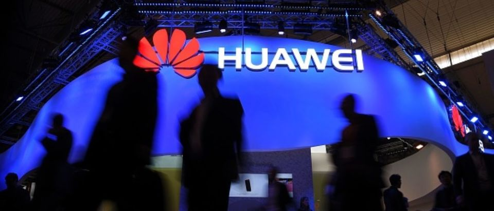 Visitors pass in front of the Huawei's stand on the first day of the Mobile World Congress in Barcelonaon on February 27, 2017 in Barcelona. (Photo: LLUIS GENE/AFP/Getty Images)