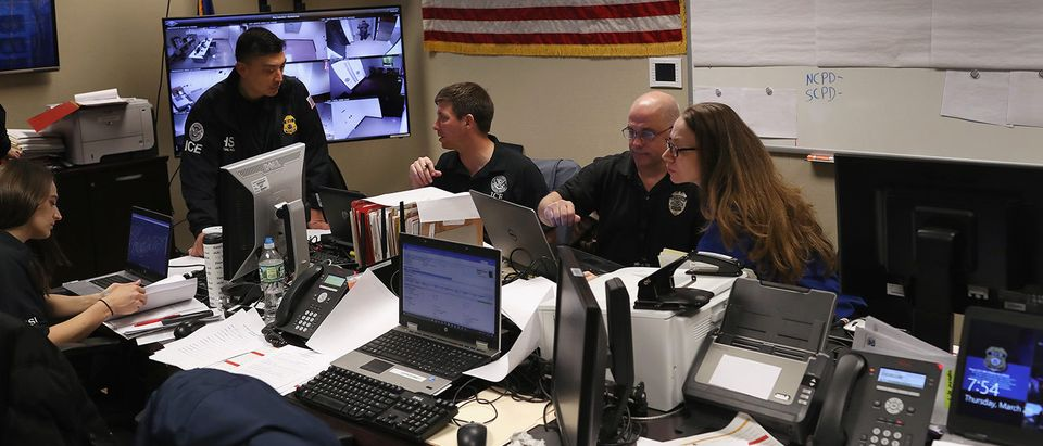 Homeland Security Investigations (HSI) ICE agents work in a control center during an operation targeting suspected immigrant gang members in Central Islip, New York. Overnight and into the morning, U.S. federal agents and local police detained suspected gang members across Long Island in a surge of arrests. The actions were part of Operation Matador, a nearly year-long anti-gang effort targeting transnational gangs, with an emphasis on MS-13. (Photo by John Moore/Getty Images)