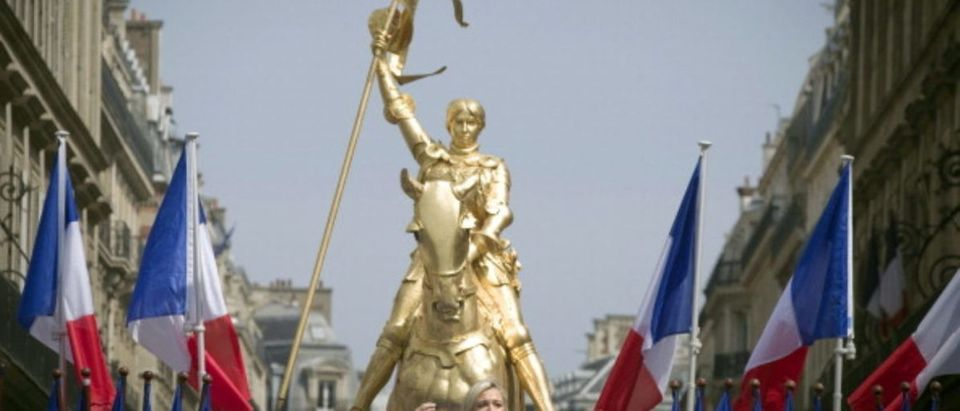 The president of French far-right party Front National (FN), Marine Le Pen, speaks in front of a statue of Joan of Arc during the party's annual celebration of Joan of Arc, on May 1, 2011 in Paris. (JOEL SAGET/AFP/Getty Images)
