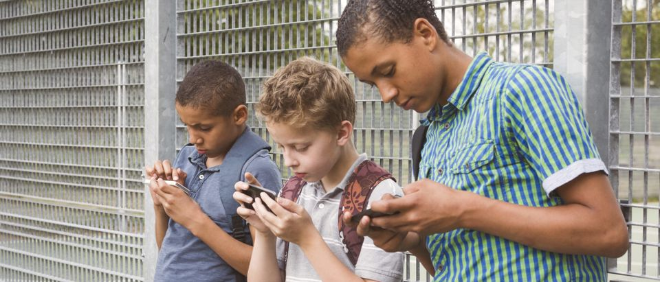The younger generation using their smartphones to go on social media platforms. [Shutterstock - Twin Design]