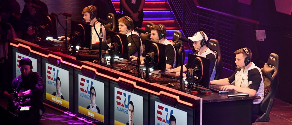 "LAS VEGAS, NV - MARCH 22: (L-R) Ben ""Benji"" McKinzey, Mike ""PolarBearMike"" Heiss, Brandon ""Venenu"" Casale, Cassidy ""Cardiac"" Cameron and Maksim ""PandaCat"" Yanevich of the eUnited esport team play in a ""Smite"" video game competition during the grand opening of Esports Arena Las Vegas, the first dedicated esports arena on the Las Vegas Strip at Luxor Hotel and Casino on March 22, 2018 in Las Vegas, Nevada. (Photo by Ethan Miller/Getty Images for Esports Arena Las Vegas)"