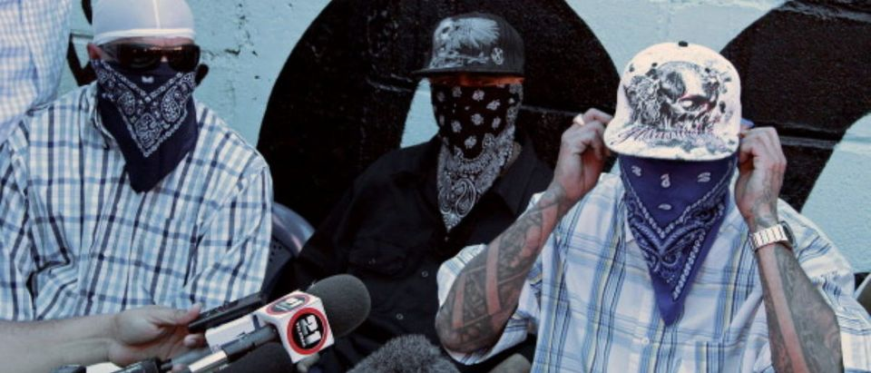 Members of the Mara Salvatrucha (MS-13) gang, offer a press conference at a prison in San Pedro Sula, 240 km north of Tegucigalpa, on May 28, 2013. (Photo: LEONEL CRUZ/AFP/Getty Images)