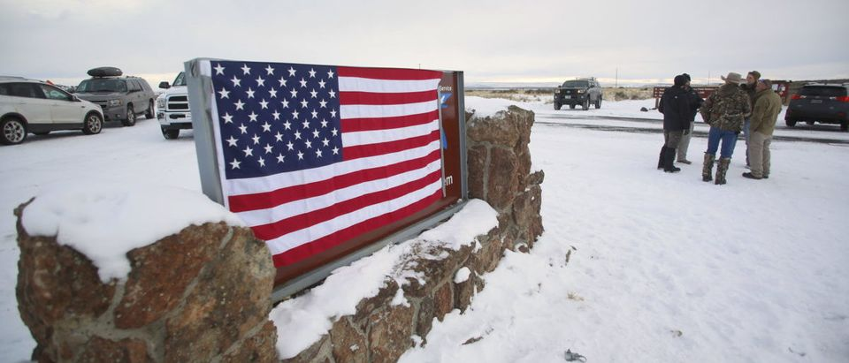 A U.S. flag covers a sign at the entrance of the Malheur National Wildlife Refuge near Burns, Oregon
