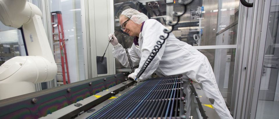 Production operator, Kathy Grady is seen at work at the SolarWorld solar panel factory in Hillsboro