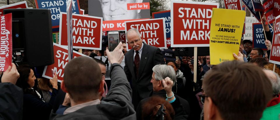 Mark Janus is cheered by supporters after speaking to them outside of the United States Supreme Court in Washington, U.S., February 26, 2018. REUTERS/Leah Millis