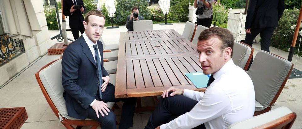 """Facebook's CEO Mark Zuckerberg (L) meets with French President Emmanuel Macron (R) at the Elysee presidential palace following the """"Tech for Good"""" summit in Paris on May 23, 2018. (Photo: CHRISTOPHE PETIT TESSON/AFP/Getty Images)"""