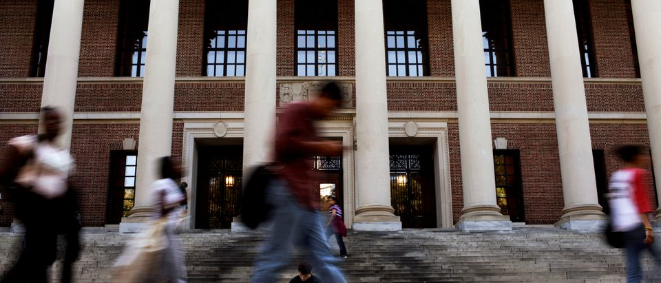 FILE PHOTO: A student sits on the steps of Widener Library at Harvard University in Cambridge