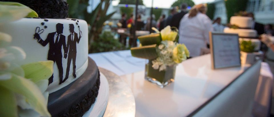Groom figurines are seen on a cake at a ceremony to celebrate the wedding of Jeff Zarrillo and Paul Katami at Beverly Hilton Hotel in Beverly Hills, California June 28, 2014. A year after becoming among the first same-sex couples to wed legally in California, the two men who were plaintiffs in the case that led to a court overturning the state's five-year ban on gay marriage held a lavish ceremony on Saturday with family and friends including Hollywood stars to celebrate their wedding. REUTERS/Mario Anzuoni
