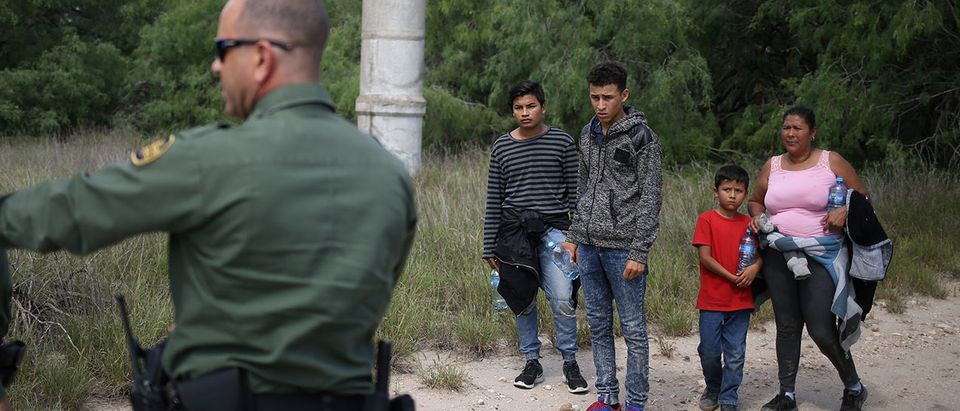 People who illegally crossed the Mexico-U.S. border turn themselves in to U.S. Border Patrol agents near McAllen