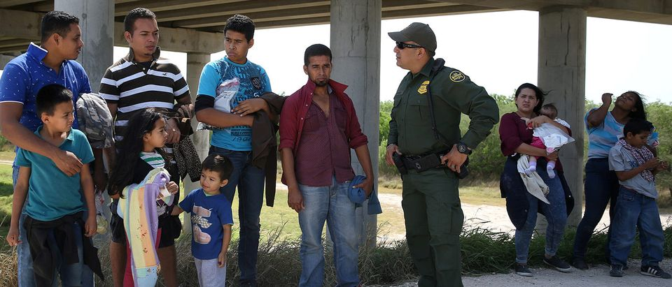 FILE PHOTO: Border patrol agent Ramirez talks with immigrants who illegally crossed the border from Mexico into the U.S. in the Rio Grande Valley sector, near McAllen