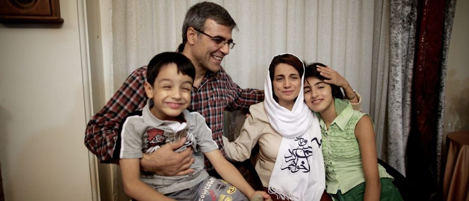 """Iranian lawyer Nasrin Sotoudeh poses with her husband, Reza Khandan, her son Nima (L) and her Daughter Mehraveh (R) at herat her home in Tehran on September 18, 2013, after being freed following three years in prison. Sotoudeh told AFP she was in """"good"""" physical and psychological condition, and pledged to continue her human rights work. Her release came a week before Irans new moderate President Hassan Rowhani, who has promised more freedoms at home and constructive engagement with the world, travels to New York to attend the United Nations General Assembly. AFP PHOTO/BEHROUZ MEHRI (Photo credit should read BEHROUZ MEHRI/AFP/Getty Images)"""