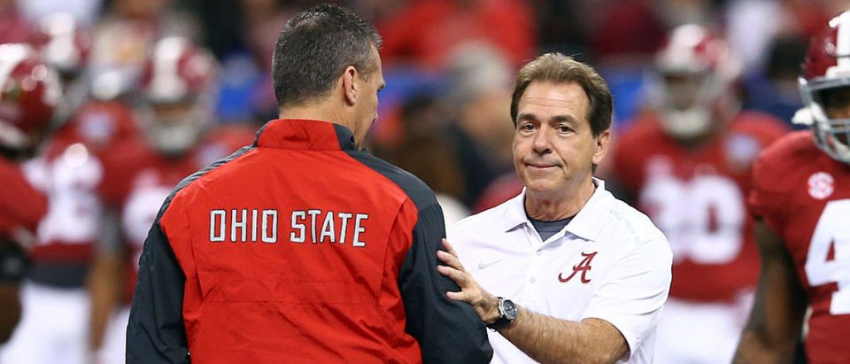 NEW ORLEANS, LA - JANUARY 01: Head coach Urban Meyer of the Ohio State Buckeyes shakes hands with head coach Nick Saban of the Alabama Crimson Tide prior to the All State Sugar Bowl at the Mercedes-Benz Superdome on January 1, 2015 in New Orleans, Louisiana. (Photo by Streeter Lecka/Getty Images)