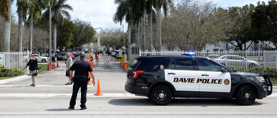Police stand guard near a school in Florida (Reuters, 06/22/18)