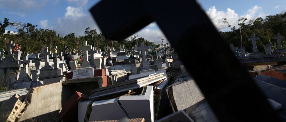 Graves destroyed during Hurricane Maria in September 2017, are seen at a cemetery, in Lares, Puerto Rico February 8, 2018. Picture taken February 8, 2018. REUTERS/Alvin Baez