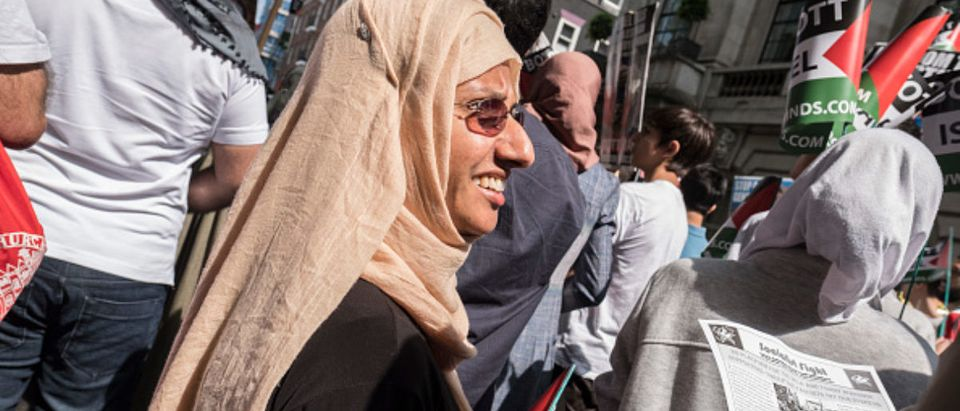 A woman smiles during the Al Quds Day rally.The Al Quds